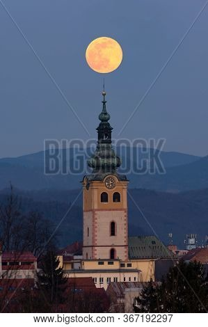 Supermoon Over Historical Centre Of Banska Bystrica. Middle-age Castle Barbican In Central Slovakia.