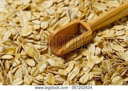 Close Up Of Oats Flakes. Oats Flakes Macro Shoot. Oatmeal Flakes Texture. Background Of Golden Oat F