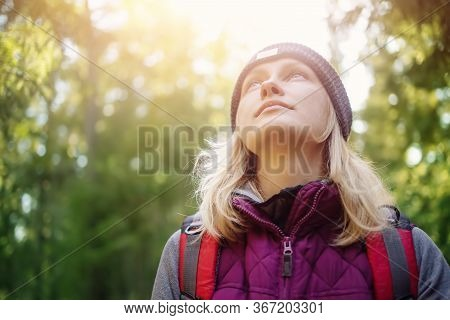 Young Woman Hiking And Going Camping In Nature