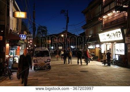 Kyoto, Japan - April 14, 2012: People Visit Streets Of Gion District In Kyoto, Japan. Old Kyoto Is A
