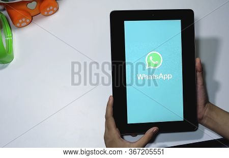 Chiang Mai, Thailand - May 20, 2020 : Woman Holding A Ipad And Open Appstore Searching Social Intern