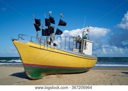 Fishing Boat On The Beach Of The Polish Baltic Coast Near Rewal