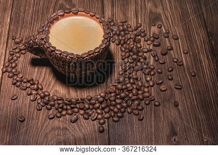 Coffee Cup With Coffee Made From Coffee Beans Wooden Table. Coffee Cup Table Tree Coffee Grain Side