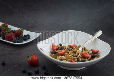 Pancake Cereal. Trendy Food, Mini Cereal Pancakes In Bowl On The Table, Grey Cement Background. Tren