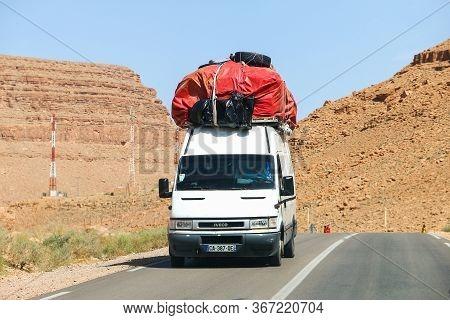 Khenifra Province, Morocco - September 27, 2019: White Cargo Van Iveco Daily In The Dry Desert.