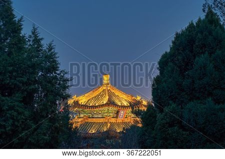 Night View Of Illuminated Pagoda On Top Of The Jingshan Park Hill (prospect Hill) In Central Beijing