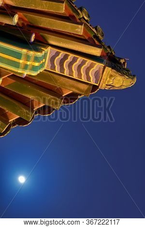 Moonrise Above The Old Pagoda On Top Of The Jingshan Park Hill In Beijing, China