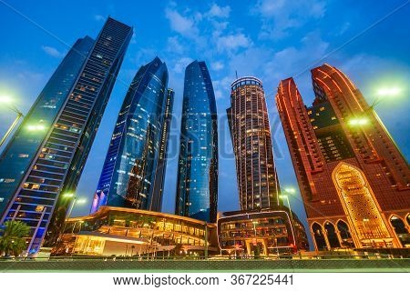 Abu Dhabi Skyline At Sunset. Abu Dhabi Is The Capital And The Second Largest City Of The United Arab