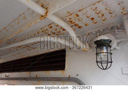 Rust Bleeding Through White Paint On A Boat Interior, Vintage Light Fixture, Horizontal Aspect