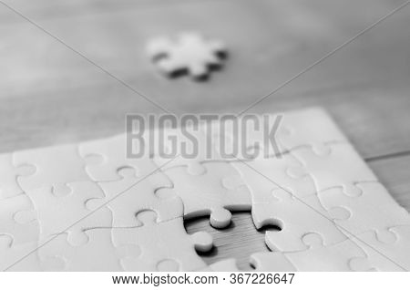 Puzzle With One Missing Piece. Puzzle With A Missing Piece On A Wooden Background, For Business Conc