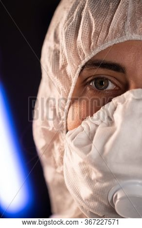 Portrait Of Epidemiologist Protecting Patients From Coronavirus Covid-19 In Mask. Doctor Virologist