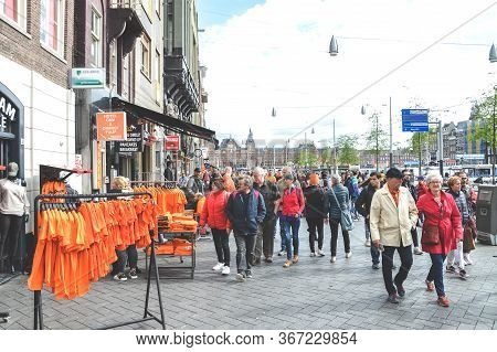 Amsterdam, Netherlands - April 27, 2019: Stands With Orange T Shirts On The Street Of The Dutch Capi