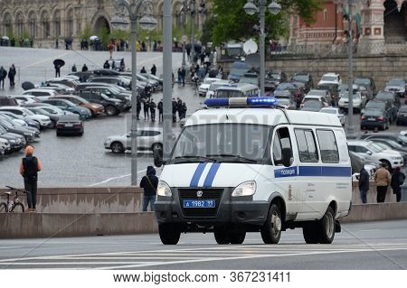Moscow, Russia - May 9, 2020:a Police Car Moves Along Vasilyevsky Descent In Moscow