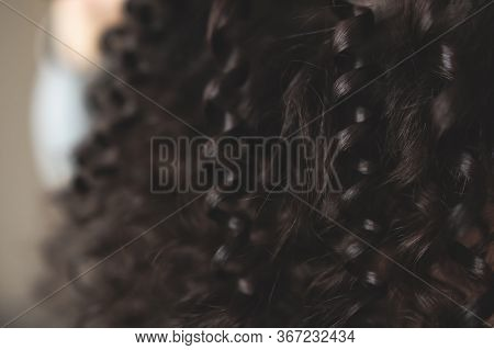 Beautiful Chocolate-colored Curls Closeup. Soft Focus On The Curls. Beautiful Background Image. Wome