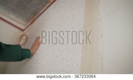 Woman Hanging Wallpaper. Master - Woman Glues Wallpaper In The Apartment. Repair In The New Building