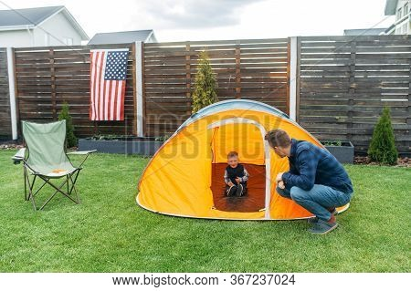 Father And Son Play Camp In The Backyard. Young Father And His Little Toddler Boy Are Playing Togeth