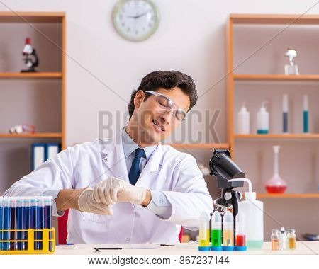 Young handsome biochemist working in the lab