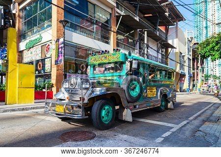 Manila, Philippines - February 24, 2013: Jeepneys Are Popular Public Transport In The Manila City In