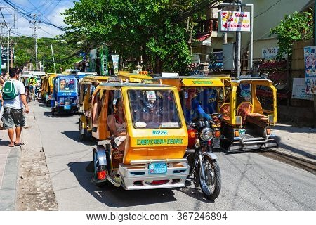 Boracay, Philippines - March 04, 2013: Tricycle At The Main Street In Boracay Island. Tricycle Is A