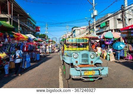 Manila, Philippines - March 17, 2013: Jeepneys Are Popular Public Transport In The Manila City In Ph