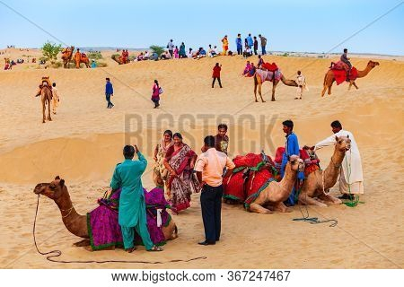 Jaisalmer, India - October 13, 2013: Unidenfified People And Camels At Safari In Thar Desert Near Ja