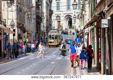 Lisbon, Portugal - June 24, 2014: Yellow Tram Is The Symbol Of Lisbon Or Lisbon, The Capital And The
