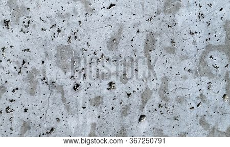 A Gray Concrete Wall Interspersed With White Plaster. Background. Blur Abstract Blank Gray Cement Co