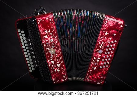 Russian Folk Instruments.red Bayan On A Black Background.russian Accordion
