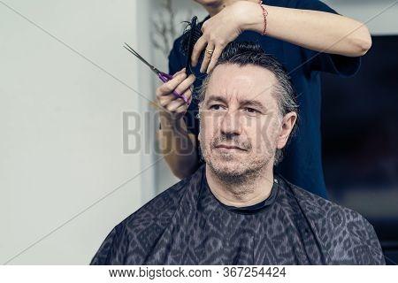 Wife Cuts The Hair On Husband At Home During Quarantine Amid Covid-19 Coronavirus Pandemic