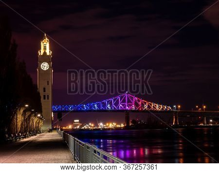 View Of The Jacques-cartier Bridge Illuminated With The Colors Of The Rainbow Concerning The Covid-1