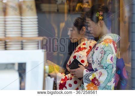 Kyoto, Japan - November, 8, 2019: Two  Young Japanese Girls Wearing Traditional Geisha's Kimono At A