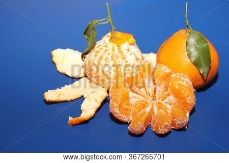 Fresh Mineola Tangerines With Leave On The Blue Background. The Concept Of Healthy Eating, Citrus An