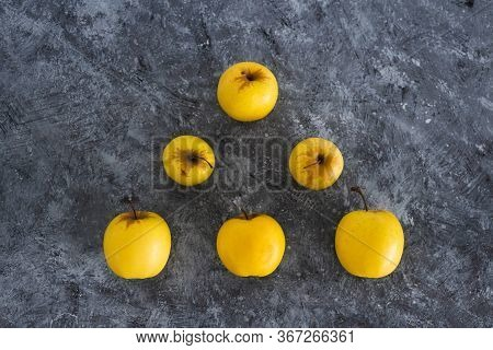 Healthy Plant-based Ingredients Concept, Group Of Golden Delicious Apples Lined Up In Triangle Shape