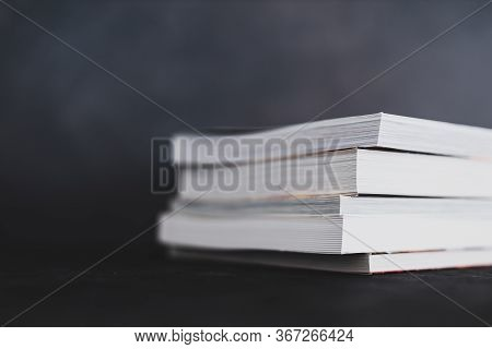 Stack Of Books Shot From Eye Level With Shallow Depth Of Field.