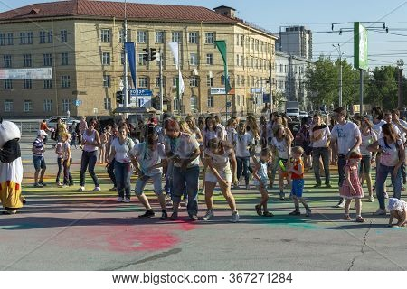 Russia, The City Of Novosibirsk, Limenov Square, June 21, 2014. Holi Festival Of Colors. Happy Young