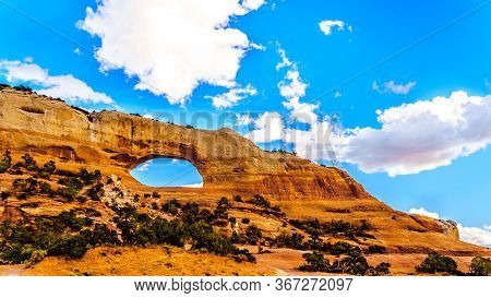 Wilson Arch Under Blue Sky, A Sandstone Arch Along Us Highway 191, South Of The Town Of Moab In Utah