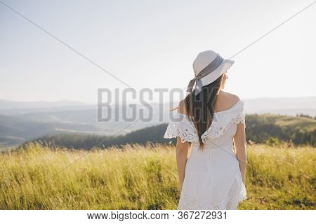 Back View Of Girl Running On The Mountain Valley. Happy Woman Having Fun Running In Field Nature Exc