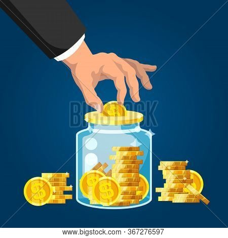 Capital Saving. Businessman Hand Putting Golden Coin Into Glass Jar. Wealth And Capital Investment,