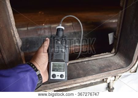 Human Holding The Equipment.using The Gas Detector For Detect Combustible Gas , Flammable Gas , Toxi