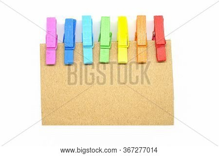 Isolated Brown Notepad With Colorful Clip On White Background.