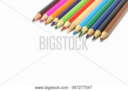Closeup Of Coloured Pencils Isolated On White Background.
