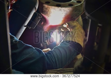 The Welder Is Assembling Valve To The Pipe Line With Tungsten Inert Gas Welding Process (tig). The W