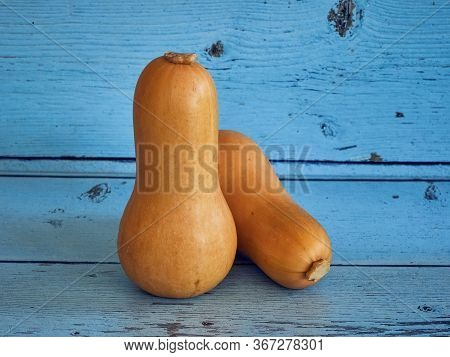 Butternut Squash On Blue Planks Rustic Background