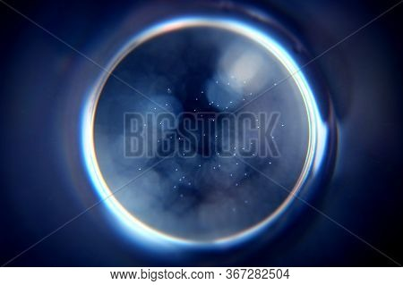 Abstract Circle On A Dark Blue Background. Blue Hole In The Dark.