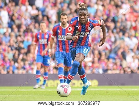 London, England - August 31, 2019: Wilfried Zaha Of Palace Pictured During The 2019/20 Premier Leagu