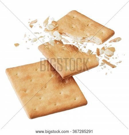 Broken Crackers Or Biscuits Isolated On White