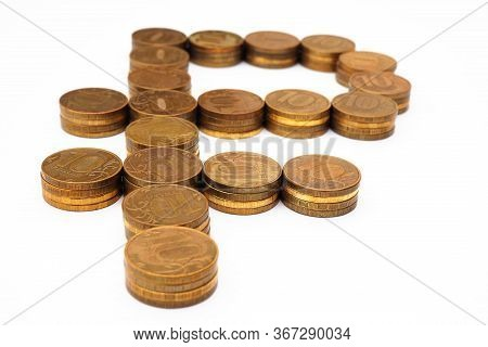 The Sign Of The Russian Ruble, Laid Out In Stacks Of Coins Of 10 Rubles. The Background Is White, No
