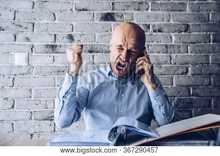 Angry Man In Shirt Furious Talking On The Phone