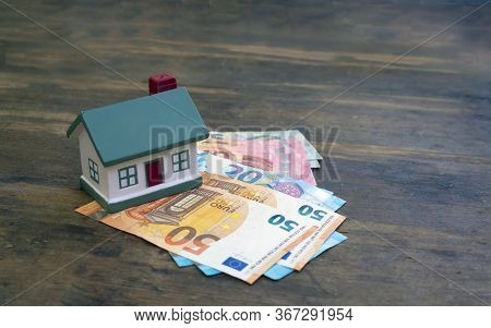 A Modern House Stands On Euro Banknotes 50, 20, 10. The Concept Of Wealth, Purchase, Sale, Rental Of