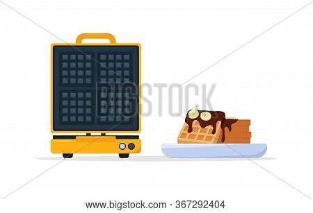 Waffle Maker And Plate Of Belgian Waffles With Chocolate Topping And Bananas